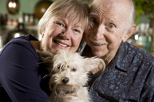Portrait-of-Senior-Couple-with-Dog