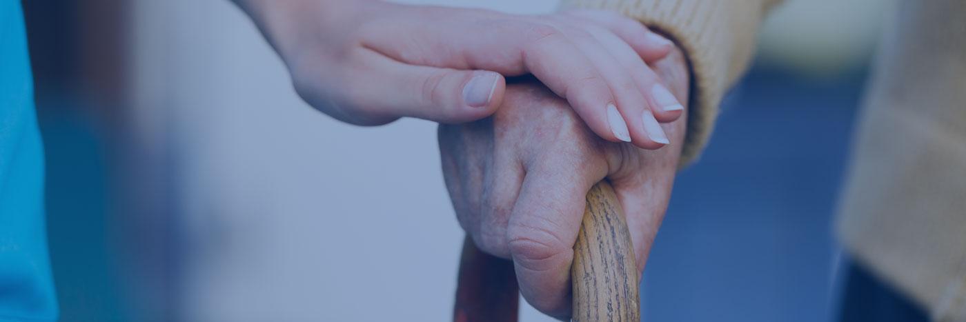 caregiver helping senior walk