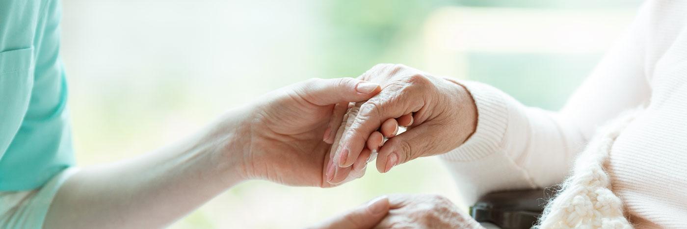 nurse-holding-patients-hands