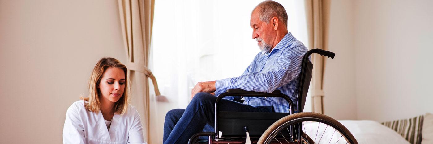 caregiver helping senior