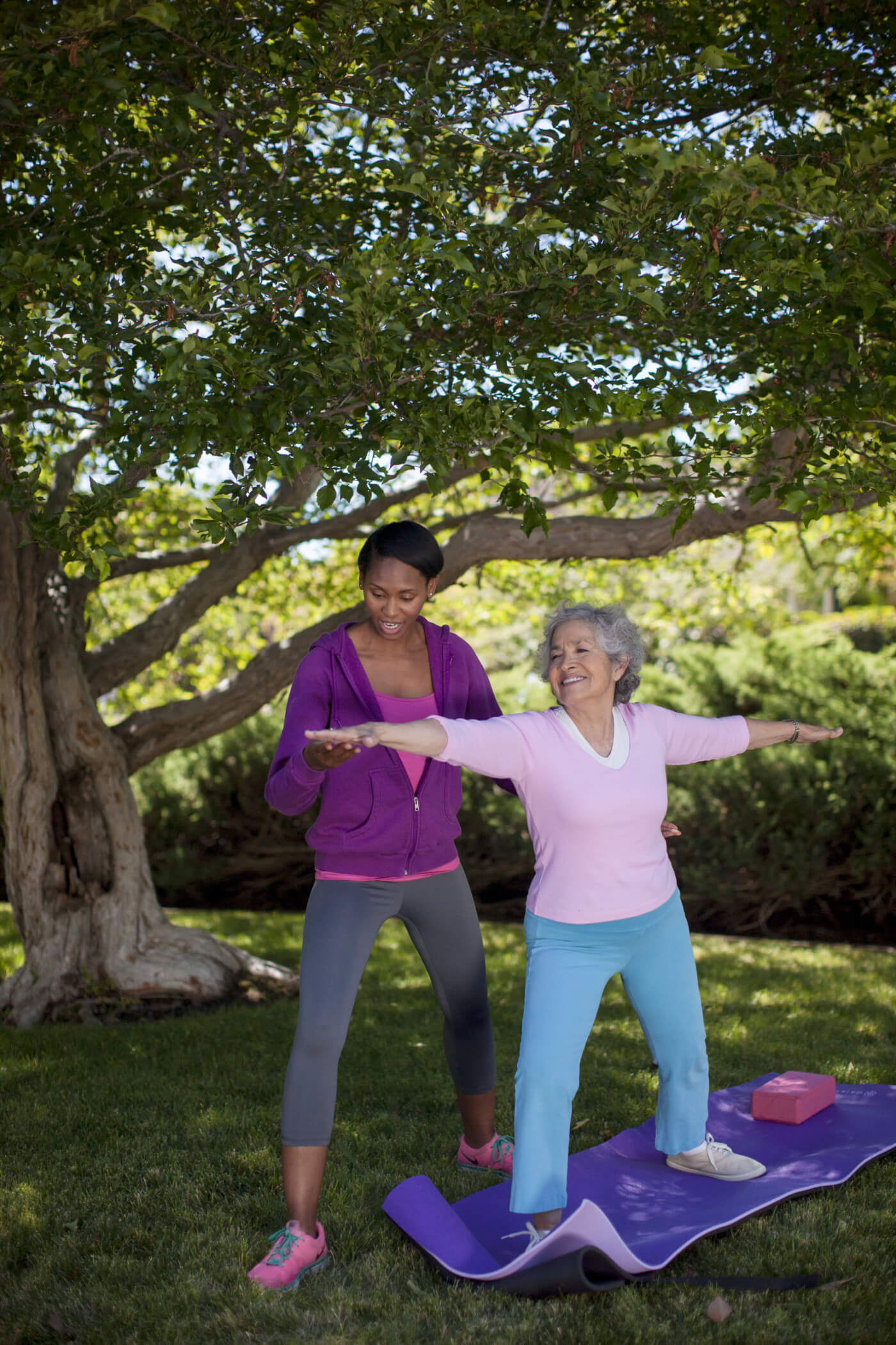 Senior doing Exercise outdoors with caregiver, Home Care Client, Home Care Exercise